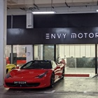 Envy director charged with cheating and fraud has links to vehicle firms